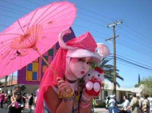 Sister Lola of the Sin Sity Sisters of Perpetual Indulgence poses with my Hello Kitty doll during the 2009 AIDS Walk.