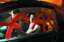 "Erin Davies inside her ""fag bug"" car at the Beauty Bar on July 26, 2007. Photo by Bill Hughes"