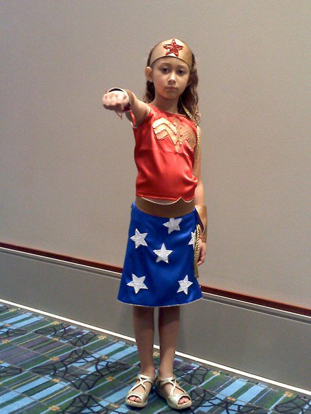 "Olivia Harris as Wonder Woman. When asked why she isn't smiling she said, ""Because Wonder Woman doesn't smile."" Take that street harassers!"