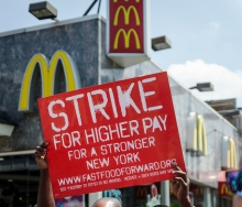 Fast food workers strike in New York, July 2013. Photo by mtume_soul via Creative Commons.
